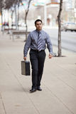 Hispanic Businessman - Walking With Briefcase Royalty Free Stock Photo