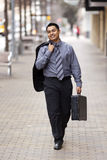 Hispanic Businessman - Walking Briefcase Royalty Free Stock Image