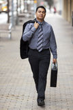 Hispanic Businessman - Walking With Briefcase Stock Photography