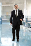 Hispanic Businessman Walking Stock Photo
