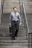 Hispanic Businessman - Walking Down Staircase Royalty Free Stock Photos