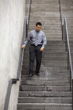 Hispanic Businessman - Walking Down Staircase Stock Image