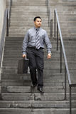 Hispanic Businessman - Walking Down Staircase Stock Images