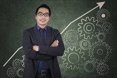 Hispanic businessperson and line chart Stock Image