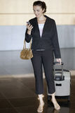 Hispanic businesswoman at airport Stock Photo