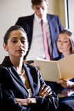 Hispanic businesswoman and colleagues Royalty Free Stock Photo
