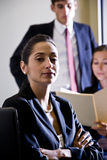 Hispanic businesswoman and colleagues Stock Images