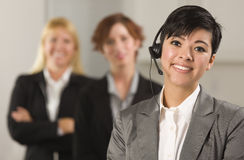 Hispanic Businesswoman with Colleagues Behind Stock Photos