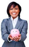Hispanic Businesswoman holding a piggy-bank Stock Images