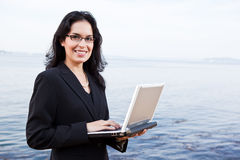 Hispanic businesswoman with laptop Royalty Free Stock Photography