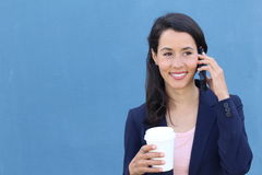 Hispanic businesswoman office worker communicating with mobile phone on coffee break with copy space Stock Photo