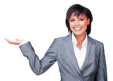 Hispanic businesswoman with open palm smiling Royalty Free Stock Images