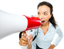 Hispanic businesswoman shouting megaphone loudspeker  Stock Photo
