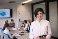 Hispanic businesswoman with tablet at meeting room Stock Image