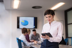 Hispanic businesswoman with tablet at meeting room Royalty Free Stock Photo