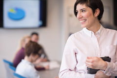 Hispanic businesswoman with tablet at meeting room Royalty Free Stock Photography