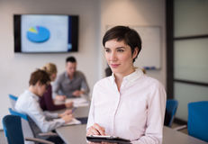 Hispanic businesswoman with tablet at meeting room Royalty Free Stock Images