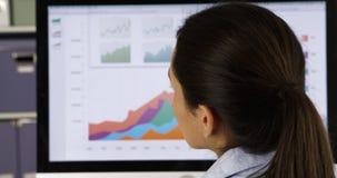 Hispanic businesswoman working on computer Stock Image