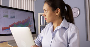 Hispanic businesswoman working hard with tablet Royalty Free Stock Image