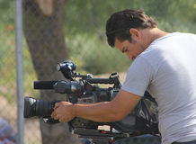 Hispanic cameraman videographer Stock Photos