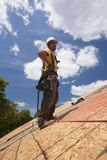 Hispanic carpenter hands on hips on roof Royalty Free Stock Photos