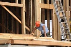 Hispanic Carpenter sorting wood Royalty Free Stock Photo
