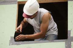 Hispanic carpenters preparing a window frame Royalty Free Stock Photos