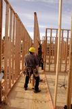 Hispanic carpenters setting a wall Royalty Free Stock Image