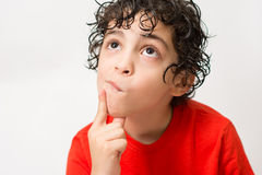 Hispanic Child Expressions of sadness, wondering and dispair. Boy with curly hair making different mood expressions. White. Sad Hispanic boy looking away. White stock images