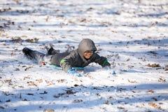 Hispanic Child Having Fun Sledding on the Snow Royalty Free Stock Photography