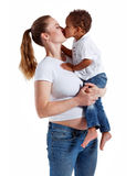 Hispanic child kissing mother. Royalty Free Stock Photo