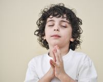 Hispanic Child Praying Stock Image