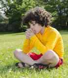 Hispanic Child Praying Outdoors. Reverence and praise of a young Latin boy to his Creator in Heaven Royalty Free Stock Image