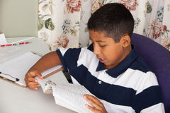 Hispanic Child Reading Stock Photo