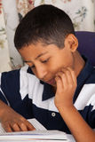 Hispanic Child Reading Royalty Free Stock Photos