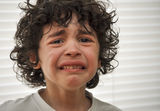 Hispanic Child Sad and Crying Stock Image