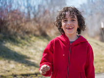 Hispanic Child Walking in a Park at the End of the Winter Stock Photo