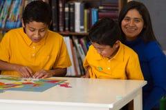 Hispanic Children Enjoying Time Fun Time with Mom. In Classroom royalty free stock photos