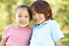 Hispanic Children Relaxing In Park Royalty Free Stock Images