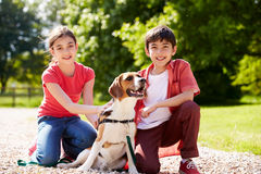 Hispanic Children Taking Dog For Walk Stock Images