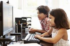 Hispanic children using computer at home Royalty Free Stock Photo