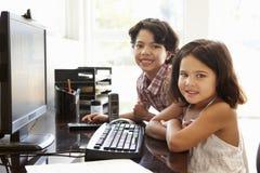Hispanic children using computer at home Stock Image