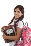 Hispanic College student. Education series - Friendly ethnic Latina female high school student with backpack and composition book Royalty Free Stock Photography