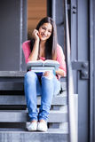 Hispanic college student studying Royalty Free Stock Image