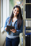 Hispanic college student using tablet PC Stock Photo