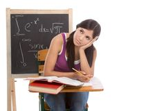 Hispanic college student woman studying math exam. Tired High school or college Latina female student sitting by the desk at math class. Blackboard with Stock Images