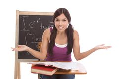 Hispanic college student woman studying math exam. Stressed High school or college Latina female student sitting by the desk at math class. Blackboard with Stock Photography