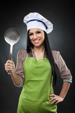 Hispanic cook with skimmer Royalty Free Stock Photos