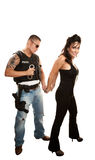 Hispanic cop arresting pretty woman Stock Photography