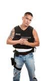 Hispanic Cop Holding Gun Stock Image